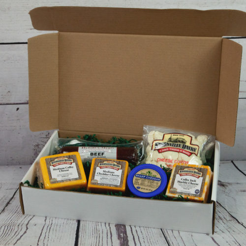 Gift box of various cheeses, sausages, and more