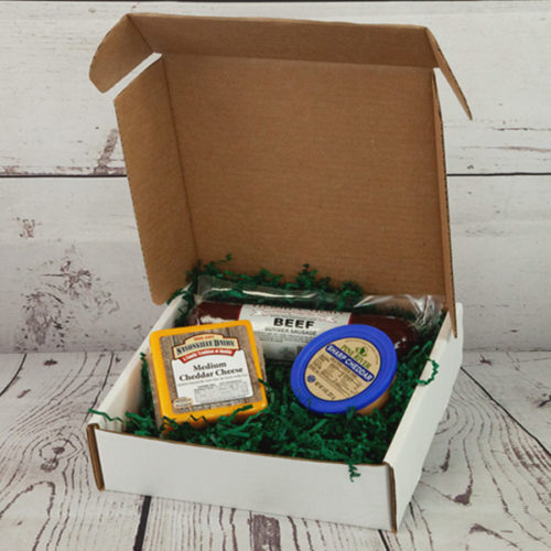 Gift box including cheese and sausage.
