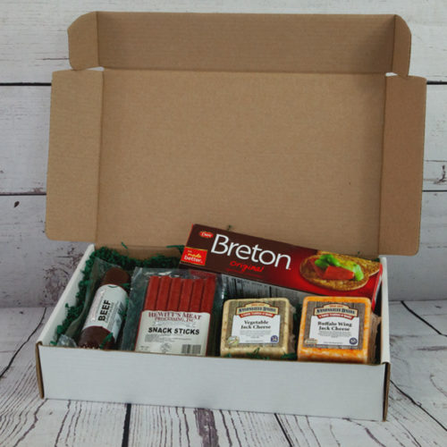 Gift box of cheeses, sausages, and crackers.