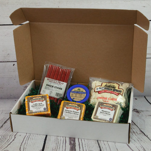 Gift box containing various cheese, sausage, and more