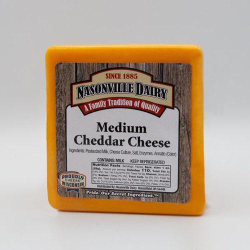 Nasonville Dairy medium cheddar cheese 16oz block.